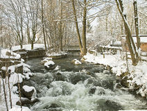 Bavarian countriside, small river with trees and snow Royalty Free Stock Image