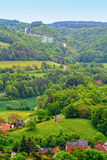 Bavarian Country Landscape. Landscape Panorama Shot from Bavaria, Germany in Summer with a little church in the front Stock Photo