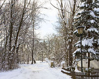 Bavarian countryside, romantic alley covered by snow with street Stock Photo