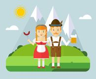 Bavarian couple with beer and sausages in mountain Stock Photos