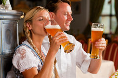Bavarian Couple drinking wheat beer royalty free stock images