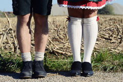 Bavarian couple, legs Royalty Free Stock Photos