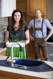 Bavarian couple standing in klitchen  and smiles Stock Image