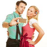 Bavarian couple taking selfie Royalty Free Stock Images