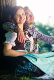Bavarian couple in Tracht hugging Royalty Free Stock Image