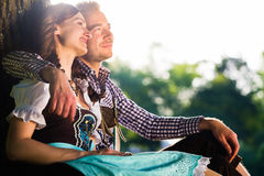 Bavarian couple in Tracht hugging Royalty Free Stock Images