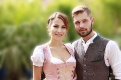 Bavarian couple in traditional costume w Royalty Free Stock Images
