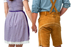 Bavarian couple. Wearing traditional dress holding hands Stock Photos