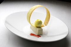 Bavarian Dessert with Olives and Ice Cream. And wafer in white plate Royalty Free Stock Photo