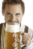 Bavarian drinks out of Oktoberfest beer stein Royalty Free Stock Image