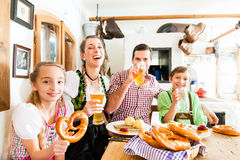 Bavarian family in German restaurant Stock Photos