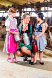Bavarian family with milk can on farm Stock Photography