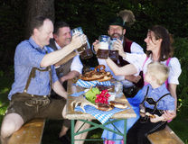 Bavarian family in the park royalty free stock images