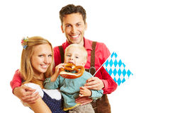 Bavarian family with pretzel Stock Photography