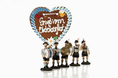 Bavarian figurines playing music and celebrating oktoberfest Royalty Free Stock Photos