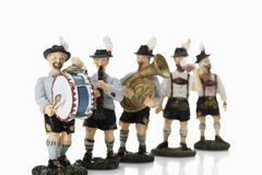 Bavarian figurines playing music on white background Stock Photography