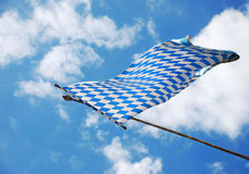 Bavarian flag. In the wind on blue and white sky royalty free stock photography
