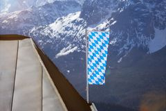 Bavarian flag in the german alps Royalty Free Stock Photo