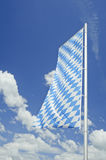 Bavarian flag with white clouds in Germany. Royalty Free Stock Photography