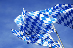 Bavarian Flags waving over Oktoberfest Stock Photos