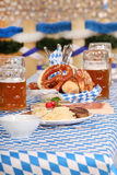 Bavarian Food. Traditional bavarian food and beer on a table in a beer tent stock photos