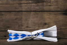 Bavarian food. Old wooden background with knife and fork. Table Royalty Free Stock Image