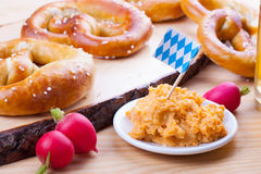 Bavarian Food - Pretzel and Obatzda at the German Oktoberfest in Munich Royalty Free Stock Images