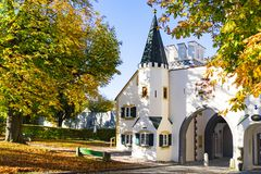 Bavarian gate and trees in autumn colors, Landsberg am Lech, Germany royalty free stock photo