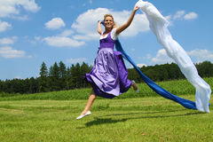 Bavarian Girl. A bavarian girl jumping and waving flags stock image