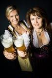 Bavarian girl. Portrait of two bavarian women in the dirndl Stock Photo