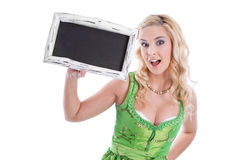 Bavarian girl with blank signboard Royalty Free Stock Photography