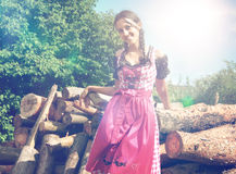 Bavarian girl in dirndl posing outside in nature Stock Photos