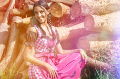 Bavarian girl in dirndl posing outside in nature Royalty Free Stock Image