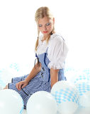 Bavarian Girl dreaming in a sky of balloons Royalty Free Stock Photography