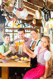 Bavarian girl with family in restaurant Royalty Free Stock Image