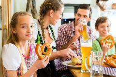 Bavarian girl with family in restaurant Stock Image