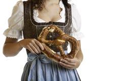 Bavarian girl  holding Oktoberfest Pretzel Royalty Free Stock Images