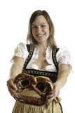 Bavarian Girl with Oktoberfest Pretzel Stock Photos