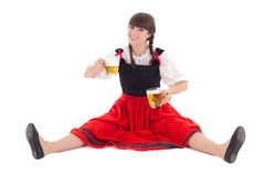 Bavarian girl sitting with cups of beer Stock Images