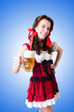 Bavarian girl with tray on white Royalty Free Stock Photo
