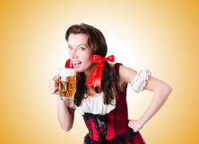 Bavarian girl with tray on white Royalty Free Stock Photography