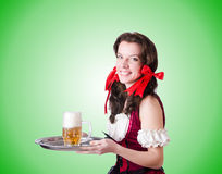 Bavarian girl with tray on white Royalty Free Stock Photos