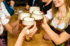 Bavarian girls drinking beer Royalty Free Stock Photography