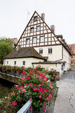 Bavarian house and bridge decorated with flowers Stock Photo