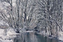 Bavarian idyllic winter landscape with river, trees and snow Stock Photo