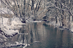 Bavarian idyllic winter landscape with river, trees and snow Royalty Free Stock Images
