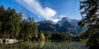 Bavarian lake at Berchtesgaden at the Alp mountains. The idyllic Hintersee in Bavarias Berchtesgaden Nationalpark with view of the mountains of the Alps and the royalty free stock photos