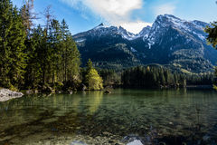 Bavarian lake at Berchtesgaden at the Alp mountains. The idyllic Hintersee in Bavarias Berchtesgaden Nationalpark with view of the mountains of the Alps and the royalty free stock photography