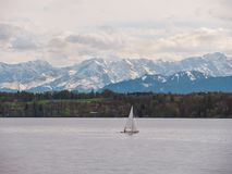 Bavarian  lake `Starnberger See` with beautiful alp mountains royalty free stock photo