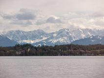 Bavarian  lake `Starnberger See` with beautiful alp mountains. Bavarian lake with with green coast and alp mountains in the backround royalty free stock photo